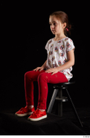 Lilly  1 dressed red leggings red shoes sitting t shirt trousers whole body 0008.jpg