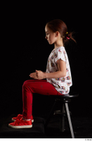 Lilly  1 dressed red leggings red shoes sitting t shirt trousers whole body 0009.jpg