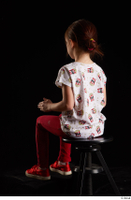 Lilly  1 dressed red leggings red shoes sitting t shirt trousers whole body 0010.jpg