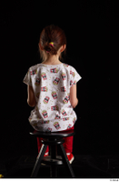 Lilly  1 dressed red leggings red shoes sitting t shirt trousers whole body 0011.jpg