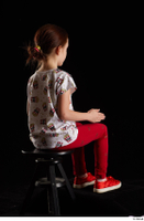 Lilly  1 dressed red leggings red shoes sitting t shirt trousers whole body 0012.jpg