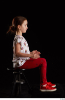 Lilly  1 dressed red leggings red shoes sitting t shirt trousers whole body 0013.jpg