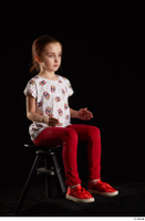 Lilly  1 dressed red leggings red shoes sitting t shirt trousers whole body 0014.jpg