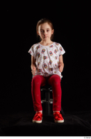 Lilly  1 dressed red leggings red shoes sitting t shirt trousers whole body 0015.jpg