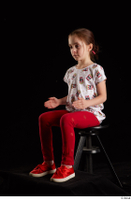 Lilly  1 dressed red leggings red shoes sitting t shirt trousers whole body 0016.jpg