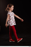 Lilly  1 dressed red leggings red shoes side view t shirt trousers walking whole body 0001.jpg
