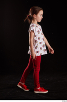 Lilly  1 dressed red leggings red shoes side view t shirt trousers walking whole body 0002.jpg