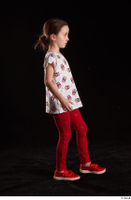 Lilly  1 dressed red leggings red shoes side view t shirt trousers walking whole body 0003.jpg