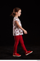 Lilly  1 dressed red leggings red shoes side view t shirt trousers walking whole body 0004.jpg