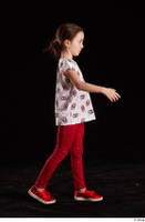 Lilly  1 dressed red leggings red shoes side view t shirt trousers walking whole body 0005.jpg