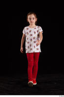 Lilly  1 dressed front view red leggings red shoes t shirt trousers walking whole body 0001.jpg