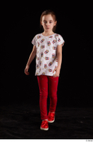 Lilly  1 dressed front view red leggings red shoes t shirt trousers walking whole body 0002.jpg