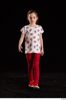 Lilly  1 dressed front view red leggings red shoes t shirt trousers walking whole body 0004.jpg