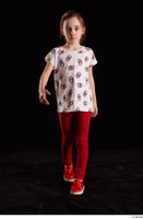Lilly  1 dressed front view red leggings red shoes t shirt trousers walking whole body 0005.jpg