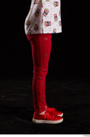 Lilly  1 dressed flexing leg red leggings red shoes side view trousers 0001.jpg