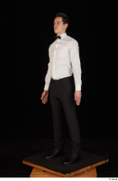 Jamie black shoes black trousers bow tie dressed standing uniform waiter uniform white shirt whole body 0002.jpg