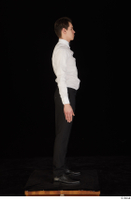 Jamie black shoes black trousers bow tie dressed standing uniform waiter uniform white shirt whole body 0007.jpg