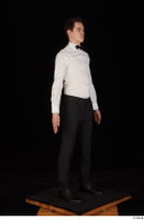 Jamie black shoes black trousers bow tie dressed standing uniform waiter uniform white shirt whole body 0008.jpg