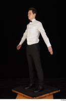 Jamie black shoes black trousers bow tie dressed standing uniform waiter uniform white shirt whole body 0010.jpg