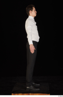 Jamie black shoes black trousers bow tie dressed standing uniform waiter uniform white shirt whole body 0015.jpg