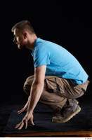 Victor  1 blue t shirt brown shoes brown trousers dressed kneeling whole body work trousers 0003.jpg