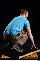 Victor  1 blue t shirt brown shoes brown trousers dressed kneeling whole body work trousers 0006.jpg