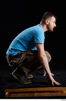 Victor  1 blue t shirt brown shoes brown trousers dressed kneeling whole body work trousers 0007.jpg