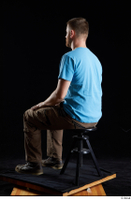 Victor  1 blue t shirt brown shoes brown trousers dressed sitting whole body work trousers 0002.jpg