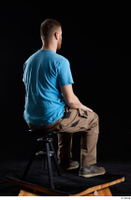 Victor  1 blue t shirt brown shoes brown trousers dressed sitting whole body work trousers 0004.jpg