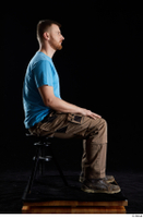 Victor  1 blue t shirt brown shoes brown trousers dressed sitting whole body work trousers 0005.jpg