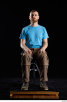 Victor  1 blue t shirt brown shoes brown trousers dressed sitting whole body work trousers 0007.jpg