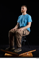 Victor  1 blue t shirt brown shoes brown trousers dressed sitting whole body work trousers 0008.jpg