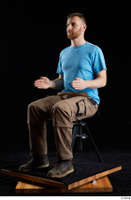 Victor  1 blue t shirt brown shoes brown trousers dressed sitting whole body work trousers 0016.jpg