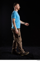 Victor  1 blue t shirt brown shoes brown trousers dressed side view walking whole body work trousers 0001.jpg