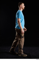 Victor  1 blue t shirt brown shoes brown trousers dressed side view walking whole body work trousers 0002.jpg