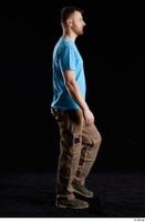Victor  1 blue t shirt brown shoes brown trousers dressed side view walking whole body work trousers 0003.jpg