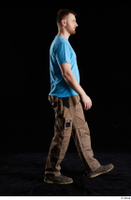 Victor  1 blue t shirt brown shoes brown trousers dressed side view walking whole body work trousers 0004.jpg
