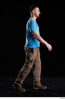 Victor  1 blue t shirt brown shoes brown trousers dressed side view walking whole body work trousers 0005.jpg