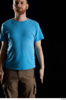 Victor  1 arm blue t shirt dressed flexing front view 0001.jpg