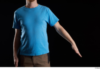 Victor  1 arm blue t shirt dressed flexing front view 0002.jpg