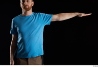 Victor  1 arm blue t shirt dressed flexing front view 0003.jpg