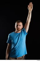 Victor  1 arm blue t shirt dressed flexing front view 0005.jpg