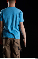 Victor  1 arm back view blue t shirt dressed flexing 0001.jpg