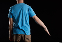 Victor  1 arm back view blue t shirt dressed flexing 0002.jpg