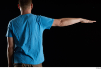Victor  1 arm back view blue t shirt dressed flexing 0003.jpg