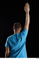 Victor  1 arm back view blue t shirt dressed flexing 0005.jpg
