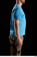 Victor  1 arm blue t shirt dressed flexing side view 0001.jpg