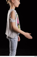 Timea  1 arm dressed flexing side view 0002.jpg