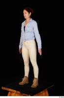 Charity blue shirt casual dressed standing white jeans whole body workers 0002.jpg