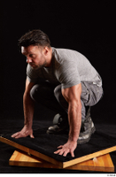 Larry Steel  1 boots dressed grey camo trousers grey t shirt kneeling shoes whole body 0002.jpg